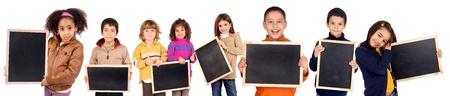 little kids holding a black board Stock Photo