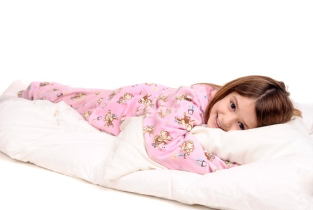 little girl on her pajamas in bed photo