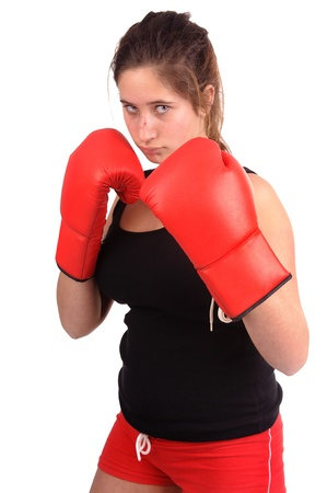 young teenage girl boxing isolated in white photo