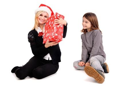 beautiful women holding christmas present Stock Photo - 19294710