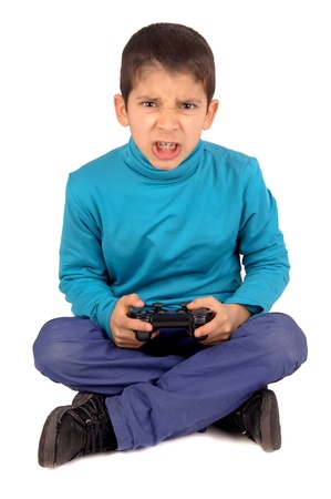 little boy playing video games photo