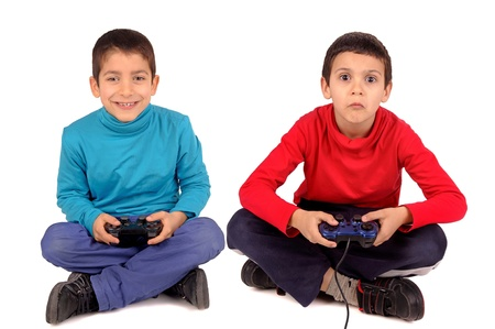 little boys playing video games photo