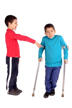 boy making fun of friend in crutches photo