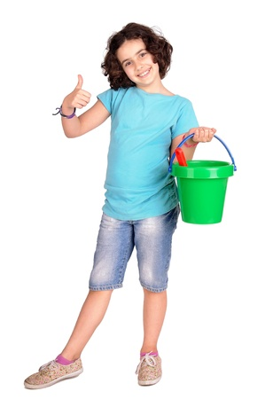 young girl with beach bucket isolated in white photo