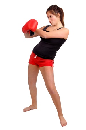 young teenage girl boxing isolated in white Stock Photo - 20999983