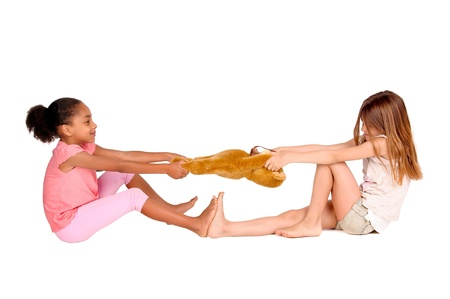 little girls fighting over a toy