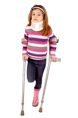 little girl with crutches isolated in white
