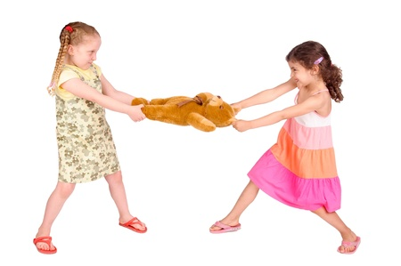 little girls fighting over a toy photo