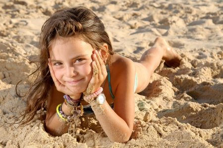 little girl on the beach photo