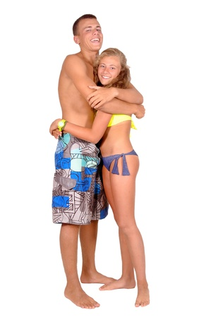 teenage girl and boy posing isolated in white photo
