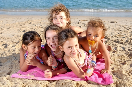 little girls on the beach  photo
