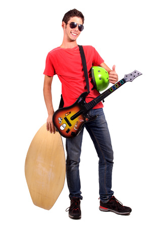 formidable: teenage boy with guitar isolated in white