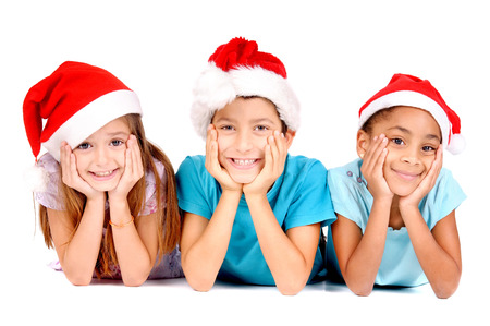 little kids with christmas hats isolated in white