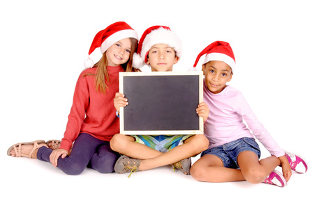 little kids with christmas hats isolated in white photo