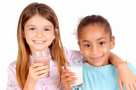 chocolate milk: little girls holding glass of milk isolated in white Stock Photo