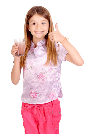 little girl holding glass of milk isolated in white Stock Photo