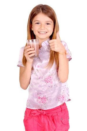milk chocolate: little girl holding glass of milk isolated in white Stock Photo
