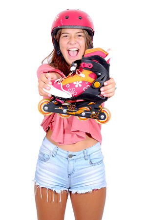 teenage girl with roller skates isolated in white photo