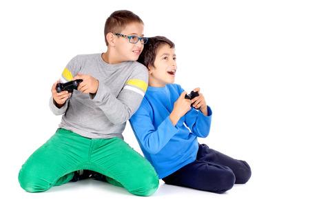little boys playing videogames Banco de Imagens