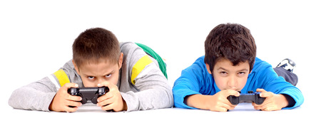 little boys playing videogames Stock Photo