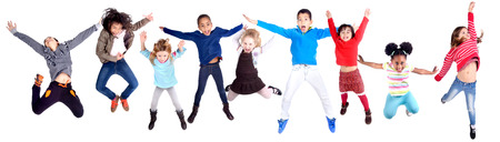 school activities: little kids jumping isolated in white Stock Photo