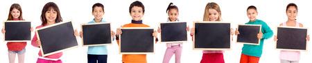 little kids holding blackboards isolated in white