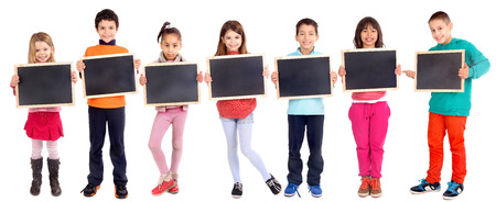 group of kids holding blackboard isolated in white Фото со стока