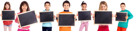 group of kids holding blackboards isolated in white
