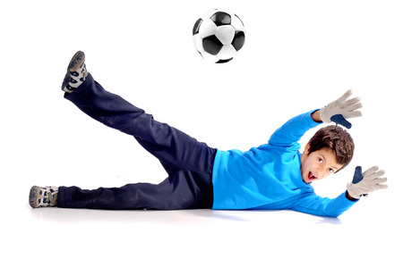 little boy playing soccer isolated in white photo