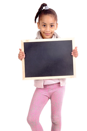 little girl holding blackboard isolated in white photo