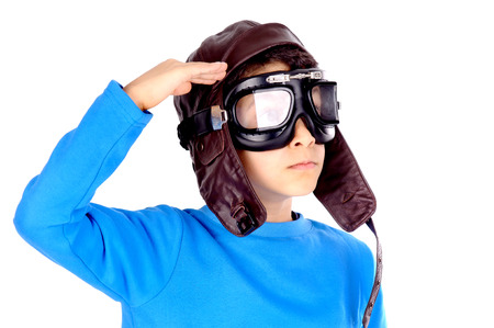 little boy pretending to be aviator isolated in white photo