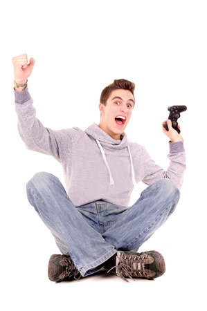 teenage boy playing videogames isolated in white