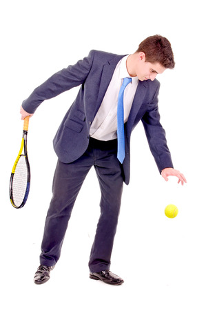young businessman playing tennis isolated in white photo