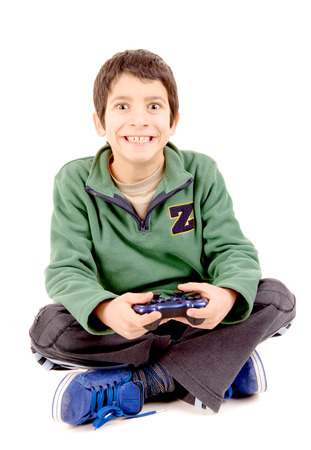 little boy playing videogames isolated in white photo