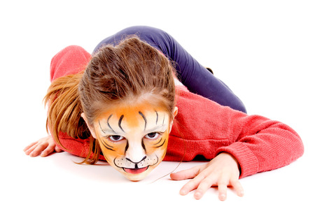 little girl painted as a tiger isolated in white photo