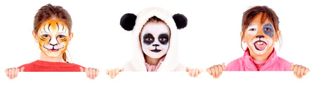 little girls wirh face paint isolated in white photo