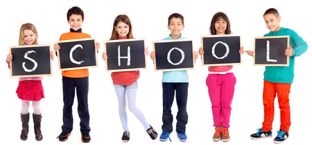 group of kids holding blackboard isolated in white Stock Photo