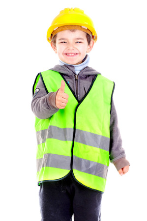 traffic warden: little boy with reflective vest isolated in white
