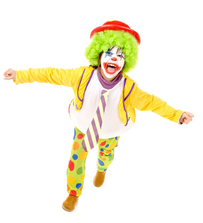 little girl dressed as a clown isolated in white photo