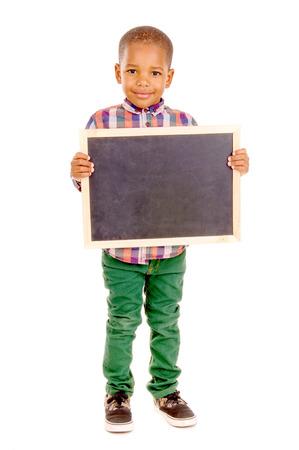 little boy holding blackboard isolated in white