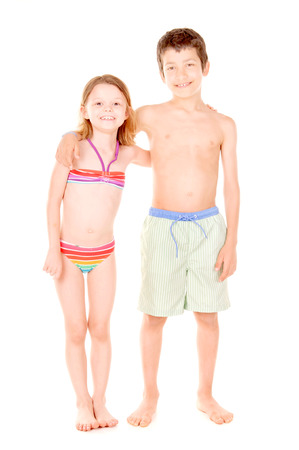 board shorts: little kids with swimsuits isolated in white