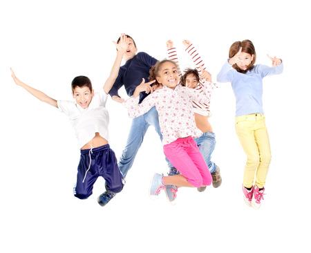 little kids jumping isolated in white Banco de Imagens