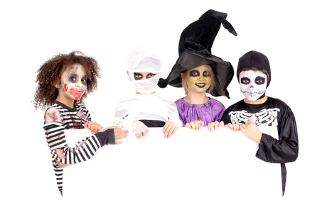 group of little kids with scary costumes on halloween isolated in white