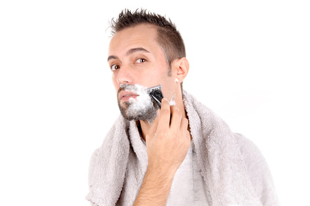 25 29: young man shaving his face isolated in white background Stock Photo
