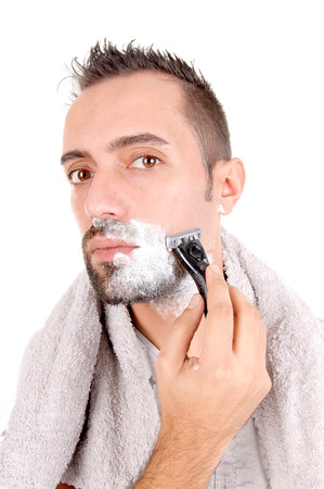 young man shaving his face isolated in white background photo