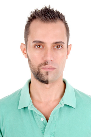 young man with half shaved face isolated in white background photo