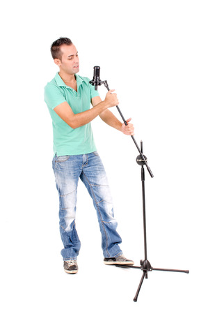 man alone: handsome young man singing isolated in white background