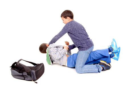little boy bullying classmate isolated in white photo