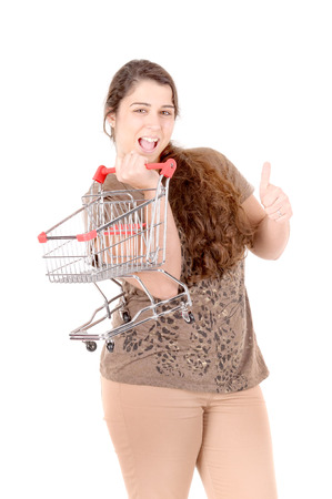 young woman with shopping cart isolated in white background photo