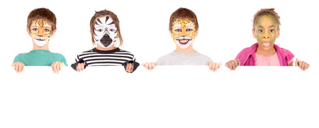 zebra face: little girl with face painted as a zebra isolated in white